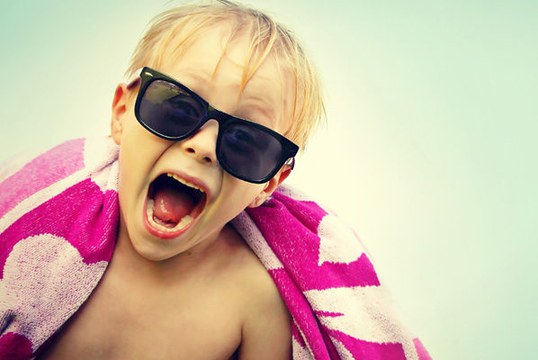 Screaming little boy in sun glasses